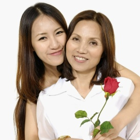 Asian mother holding rose flower with her daughter